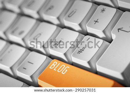 Blog business concept -Orange button or key on white keyboard - stock photo
