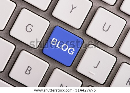 Blog button on white computer keyboard  - stock photo