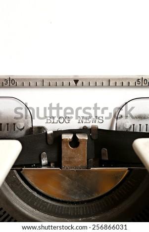 Blog news written on an old typewriter - stock photo
