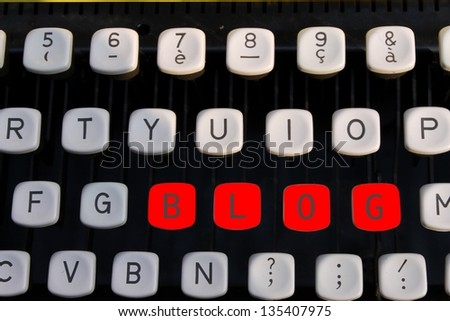 blog on old typewriter - stock photo