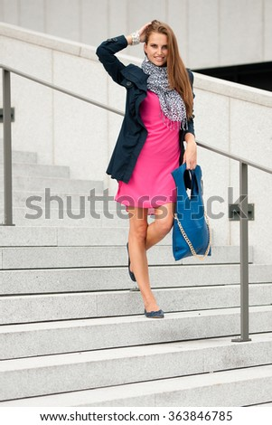Blog style fashionable woman on stairs posing