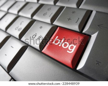 Blog web and Internet concept with sign on a red laptop computer key for website, blog and on line business. - stock photo