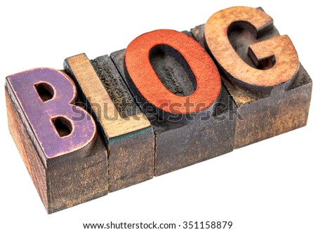 blog word abstract - an isolated banner in vintage letterpress wood type blocks stained by color inks - stock photo