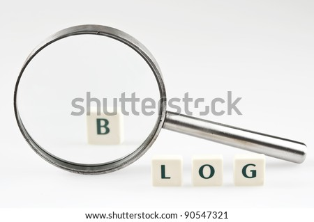 Blog word and magnifying glass - stock photo