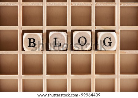 Blog word construction with letter blocks / cubes and a shallow depth of field - stock photo