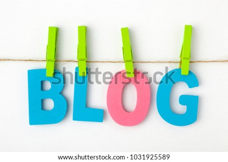 BLOG written with alphabet letters with wooden pinch on white background. Business Concept.