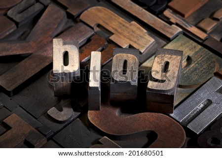 blog written with antique letterpress printing blocks on random letters background - stock photo