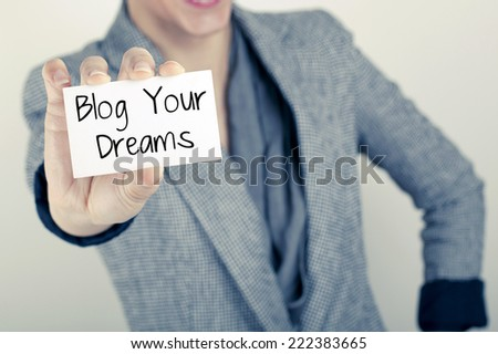 Blog Your Dreams / Woman hand holding and showing the note - stock photo