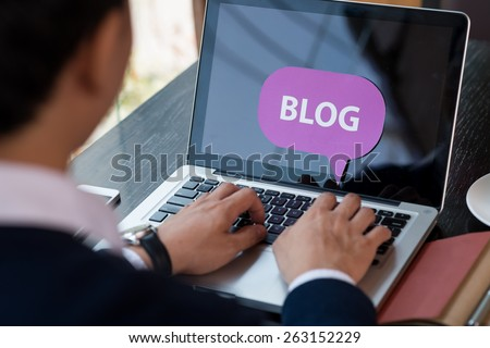 Blogging man, view over the shoulder - stock photo