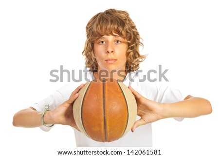 Blond adolescent boy ready to throw basketball isolated on white background - stock photo
