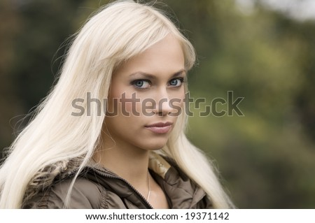 blond and nice girl with long hair in a outdoor portrait
