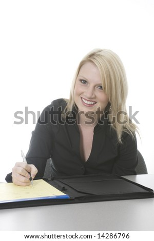 blond assistant writing in folio notebook