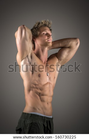 Blond athletic man with well developed abs and pecs - stock photo