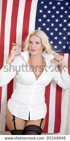 Blond attractive woman on the background of the american flag - stock photo