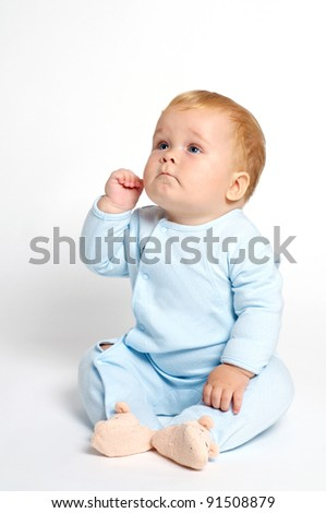 blond baby thinking smart - stock photo