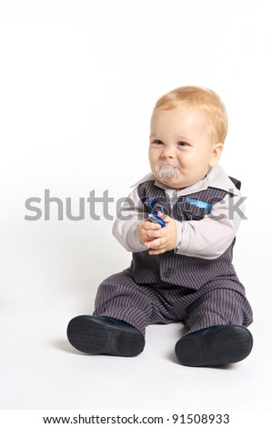 blond baby with pacifier in formal suit - stock photo