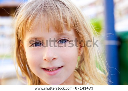 Blond beautiful kid girl portrait with blue eyes - stock photo