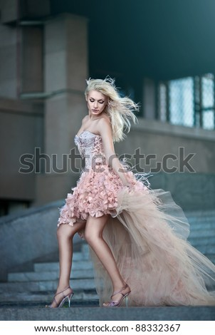 Blond beautiful luxury woman in wedding dress - stock photo