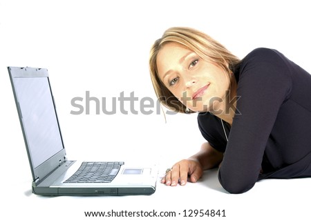 Blond beautiful woman surfing the web on the laptop