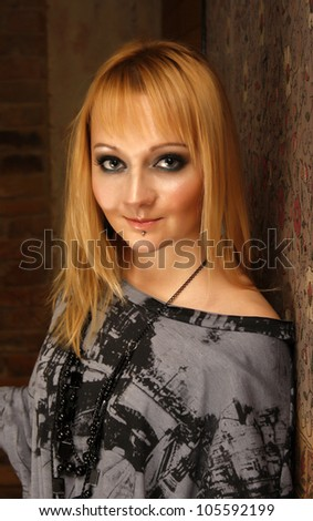 Blond beautiful woman with bright make up