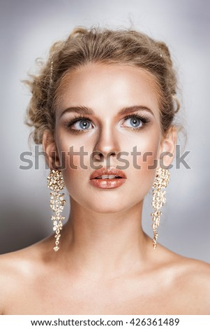 blond beauty woman portrait with golden hair jewelry and ear-rings - stock photo