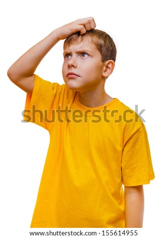 blond boy in yellow shirt is thinking scratching his head hair, confused isolated on white background - stock photo