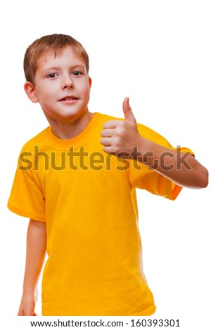 blond boy kid in yellow shirt holding a thumbs-up, showing the sign yes on a white background
