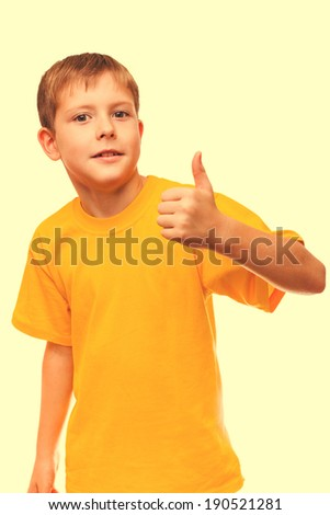 blond boy kid in yellow shirt holding a thumbs-up, showing the sign yes on a white background cross processing retro