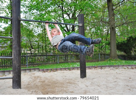 Blond boy on the playground. - stock photo