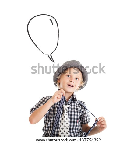 Blond boy wearing a hat, suspenders and a plaid shirt with a thoughtful face. Nearby speech bubble. - stock photo