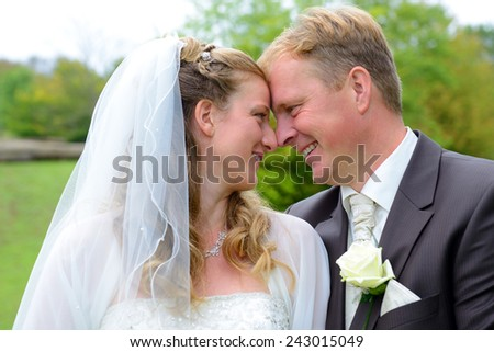 blond bridal couple in front of nature background