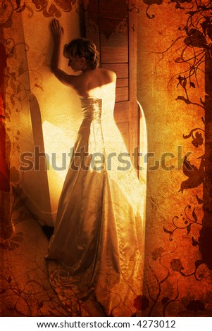 Blond bride in sleeveless wedding dress against wall standing with her back on grunge swirls and scrolls background - stock photo