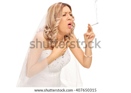 Blond bride smoking a cigarette and coughing isolated on white background - stock photo