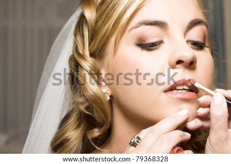 Blond bride with curly locks and beautiful features - stock photo
