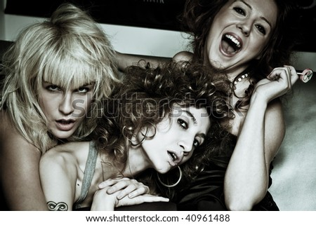 blond brunette and red hair woman on a party