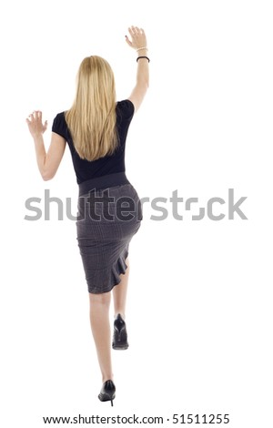 Blond business woman climbing a wall - determination, isolated over a white background