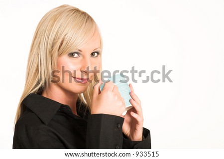 Blond business woman dressed in black trousers and a black shirt.  Holding a mug - copy space