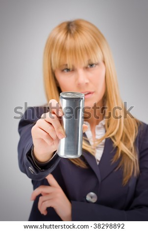Blond business woman hold metal can of energy drink in right hand