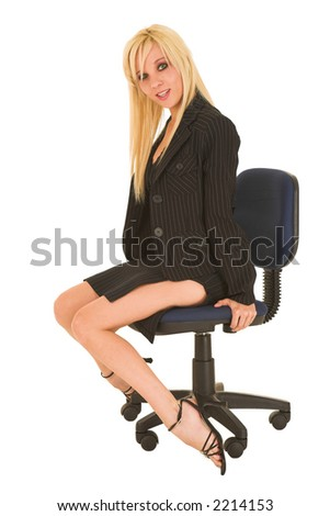 Blond business woman in small black dress