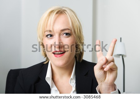 blond business woman showing the V-sign