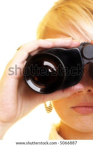 Blond business woman with binocular looking into the future - stock photo
