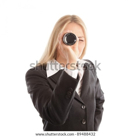 Blond business woman with spyglass looking into camera