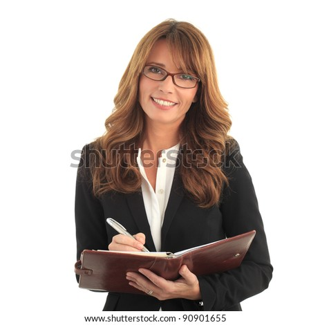 Blond business woman writing in her notebook - stock photo
