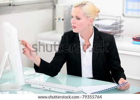 Blond businesswoman at work - stock photo