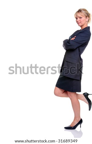 Blond businesswoman in suit standing leaning against something, isolated on a white background.