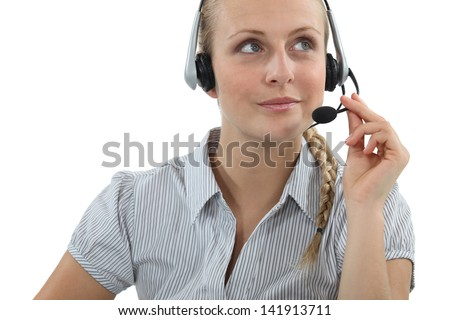 Blond call-center agent - stock photo