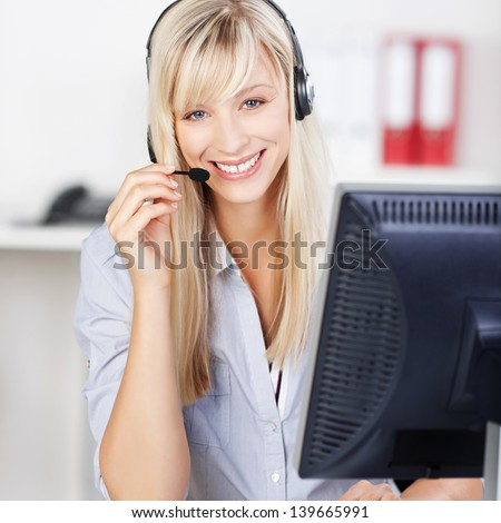 Blond call center operator smiling and answering call