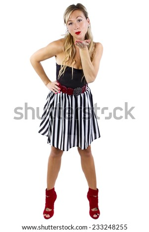 blond caucasian female blowing a kiss with hand gesture on white background - stock photo