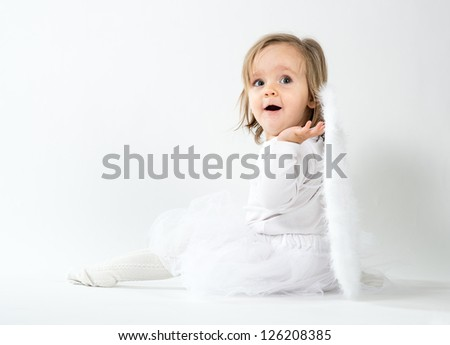 blond child in a christmas angel costume