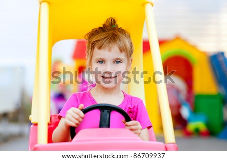 blond children girl driving toy car yellow - stock photo